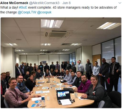 Image shows a screenshot of a tweet and a Twitter image. The tweet says: What a day! #storesofexcellence event complete. 45 store managers ready to be advocates if the change. The image is a photo of 45 managers sitting around a table.